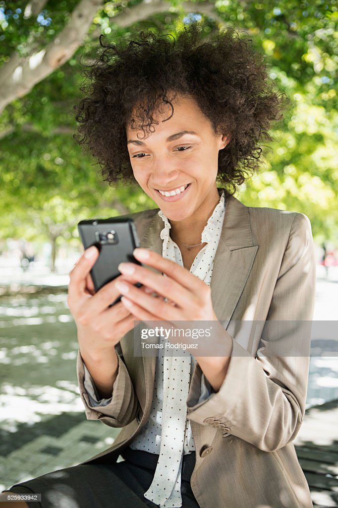 Portrait of mid adult woman using cell phone : Stock-Foto