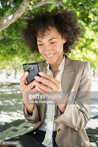 Portrait of mid adult woman using cell phone : Bildbanksbilder