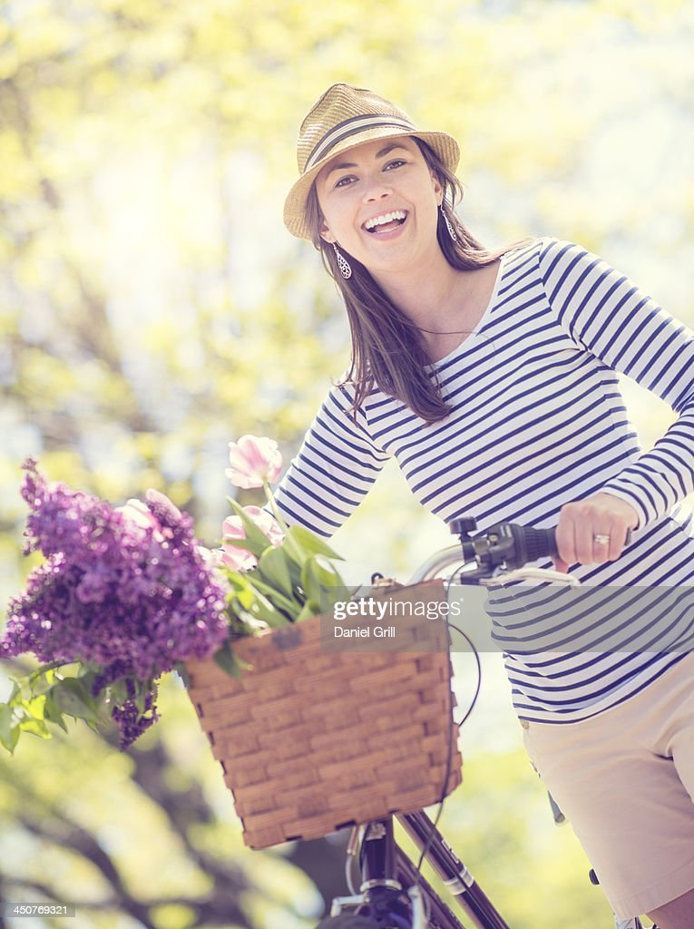 Portrait of mid adult woman with bicycle : Stock Photo