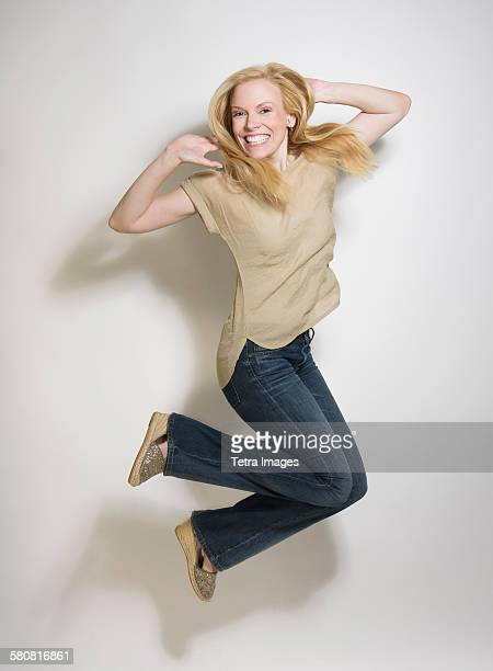 Portrait of mid-adult woman jumping
