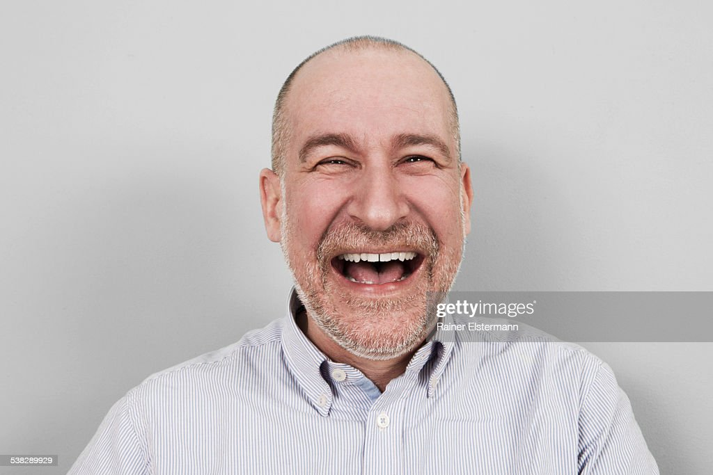 Portrait of middle aged man hysterically laughing