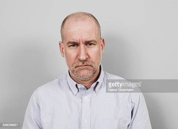 Portrait of middle aged man looking annoyed