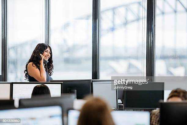 Portrait of Middle Eastern businesswoman smiling on cell phone