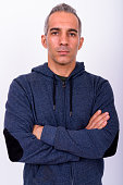 Studio Shot Of Middle Eastern Man Against White Background