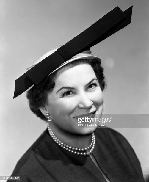 Portrait of milliner Sally Victor modeling a fashionable hat She prepares for the CBS Radio show Make Up Your Mind Image dated February 25 1954 New...