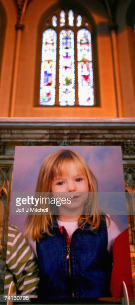 A portrait of missing toddler Madeleine McCann is propped up during a vigil and prayer service at St Andrews Roman Catholic Cathedral May 11 2007 in...