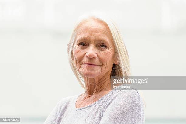 Portrait of modern attractive blond mature woman, copy space