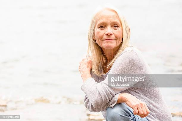 Portrait of modern attractive blond mature woman, copy space