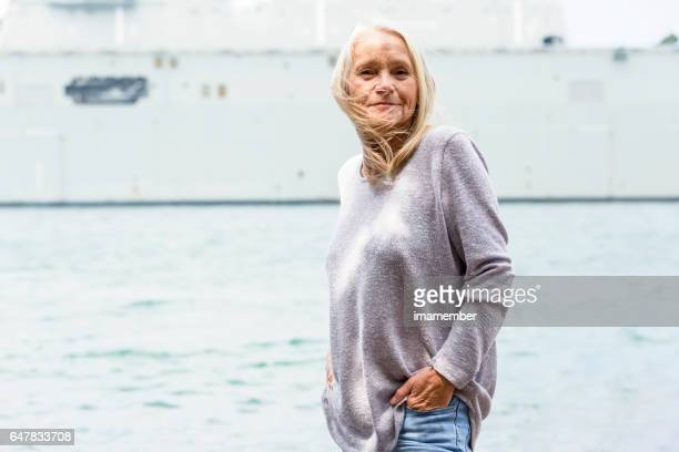 Portrait of modern attractive mature woman, outdoor, copy space