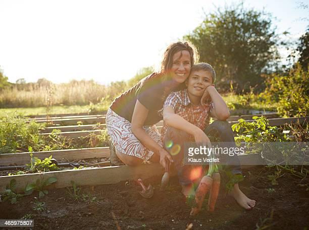 Portrait of mom & son in their vegetable garden