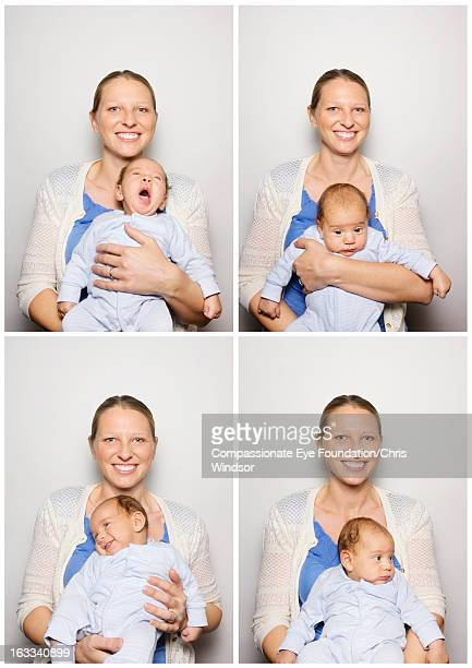 Portrait of mother and baby in photo booth