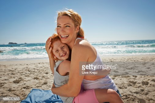 Portrait of mother and child cuddling : Stock Photo