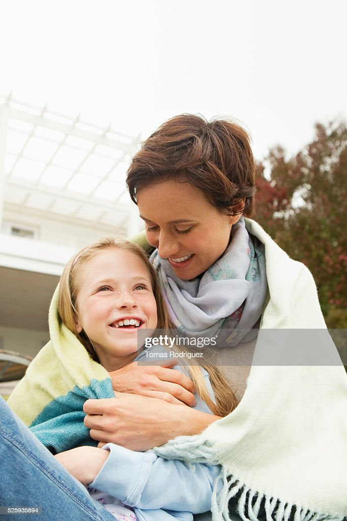 Portrait of mother and daughter (8-9) covered with blanket : Stock Photo