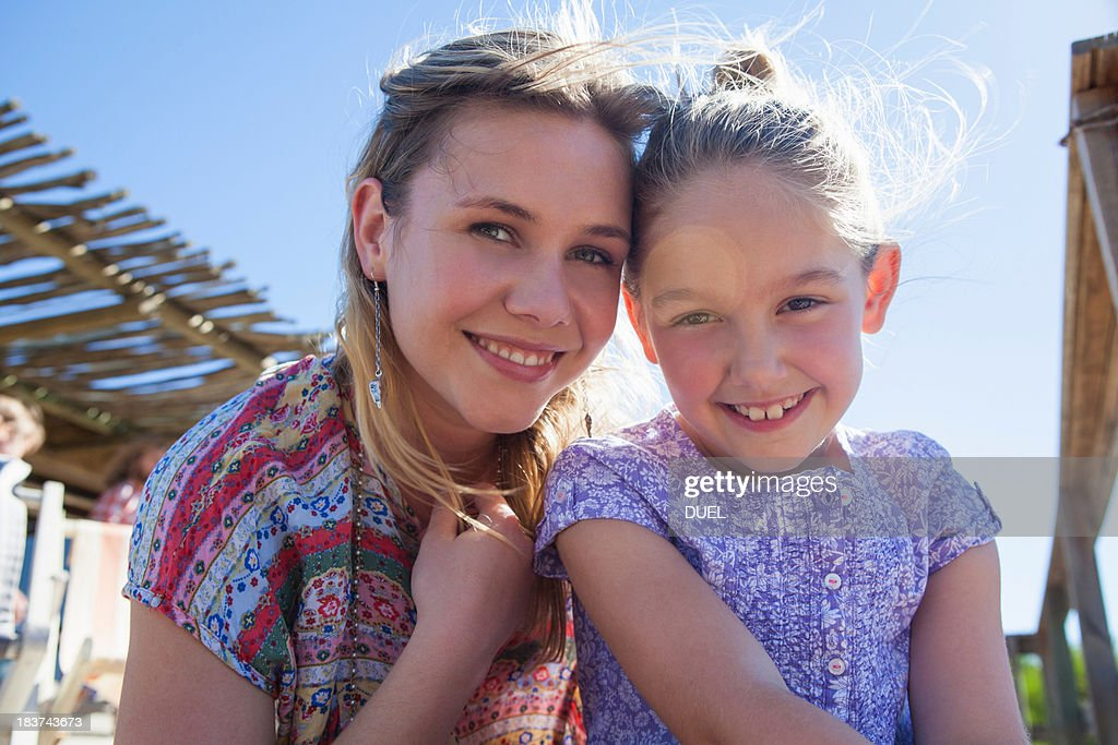 Portrait of mother and daughter in sunlight : Stock Photo