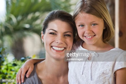 Portrait of mother and daughter outdoors : Stock Photo