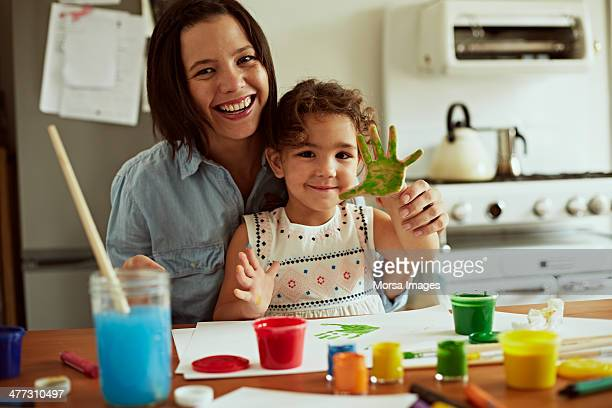 Portrait of mother and daughter painting