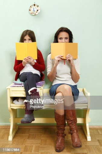 portrait of mother and daughter reading : Stock Photo