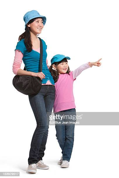 Portrait of mother and daughter travelling