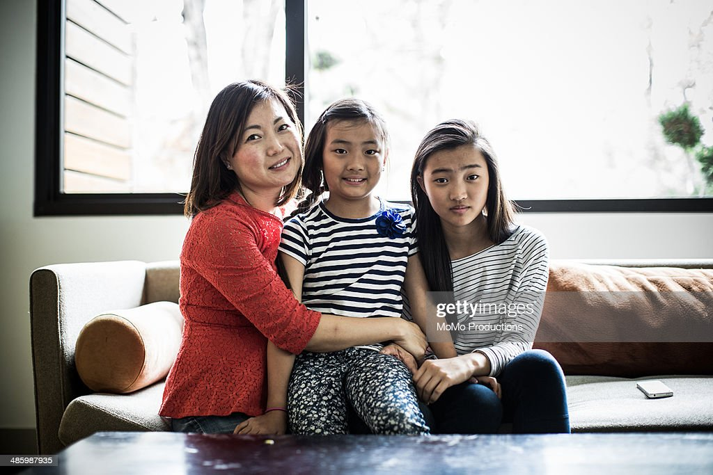 portrait of mother and daughters : Stock Photo
