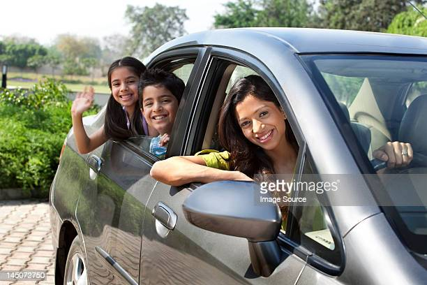 Portrait of mother and kids in a car