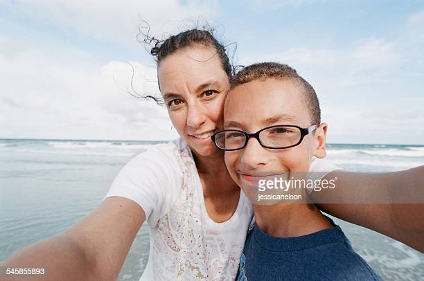Portrait of mother and son at seaside