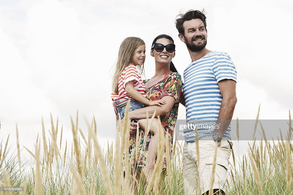 Portrait of mother, father and daughter