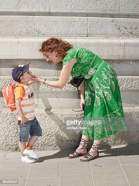 portrait of mother with child in street
