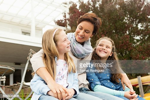 Portrait of mother with two girls (6-7), (8-9) : Stock Photo