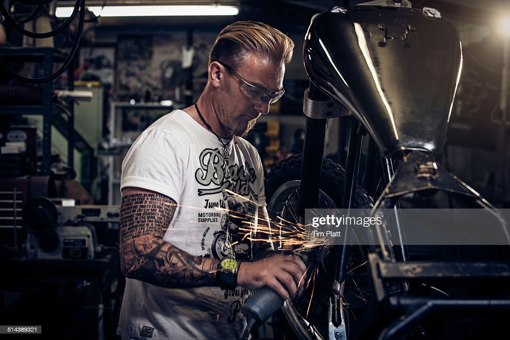 Portrait Of Motorcycle Mechanic At Work Stock Photo