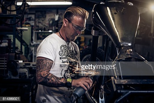 Portrait of motorcycle mechanic at work.