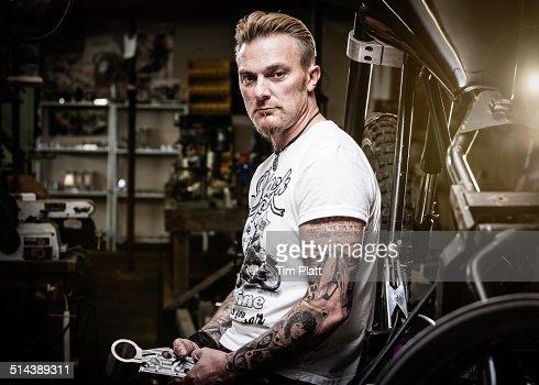 Portrait of motorcycle mechanic in his workshop.