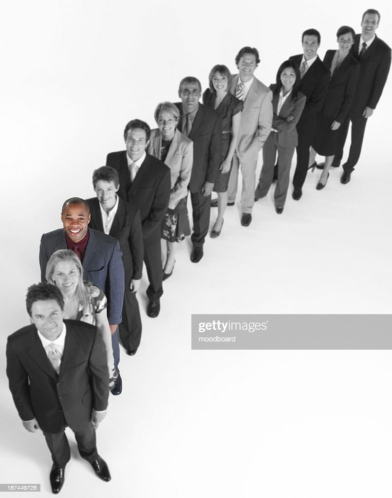 Portrait of multi-ethnic business team standing in line : Stock Photo