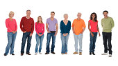 Full length portrait of multi-ethnic group standing isolated over white background.