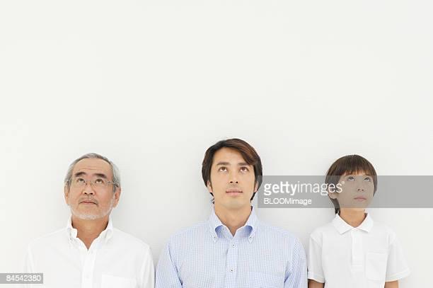 Portrait of multi-generation family, looking upward
