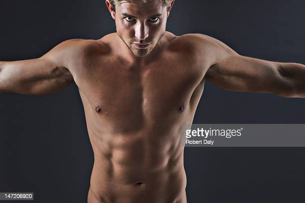 Portrait of muscular man with arms outstretched