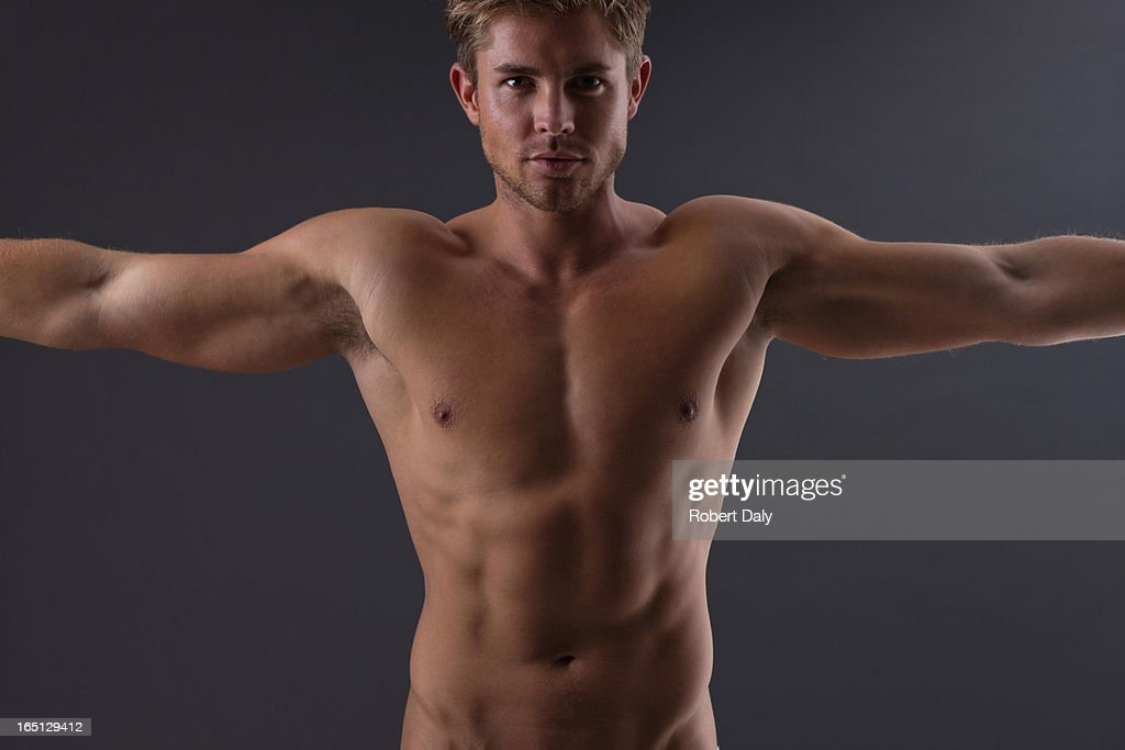 Portrait of muscular man with arms outstretched : Stock Photo