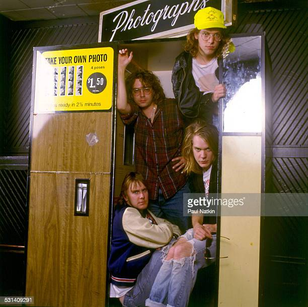 Portrait of music group Soul Asylum posing in a photo booth Chicago Illinois November 2 1990