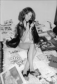 Portrait of music journalist and publicist Susan Blond as she poses in her bedroom surrounded by articles and cassette tapes New York New York...