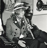 Portrait of musician Brian Jones as he plays a recorder late 1960s