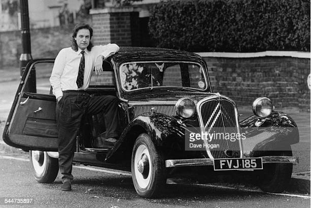 Portrait of musician Dave Davies next to his Citroen car September 24th 1984