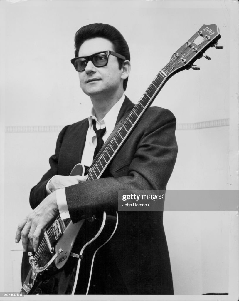 Portrait of musician <a gi-track='captionPersonalityLinkClicked' href=/galleries/search?phrase=Roy+Orbison&family=editorial&specificpeople=913944 ng-click='$event.stopPropagation()'>Roy Orbison</a>, wearing a suit and trademark sunglasses, and holding his guitar, April 13th 1967.