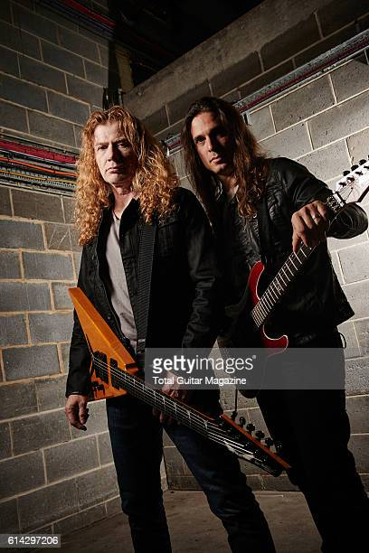 Portrait of musicians Dave Mustaine and Kiko Loureiro guitarists with thrash metal group Megadeth photographed backstage before a live performance at...