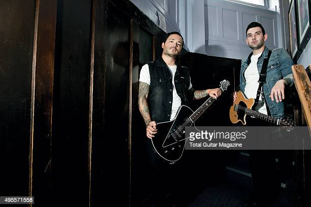 Portrait of musicians Jack Fowler and Nick Martin guitarists with American posthardcore group Sleeping With Sirens photographed backstage before a...