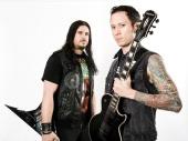 Portrait of musicians Matt Heafy and Corey Beaulieu of American heavy metal group Trivium taken on August 30 2013