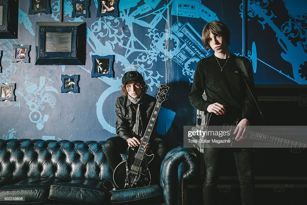 Portrait of musicians Van McCann and Johnny Bond guitarists with Welsh indie rock group Catfish And The Bottlemen photographed before a live...