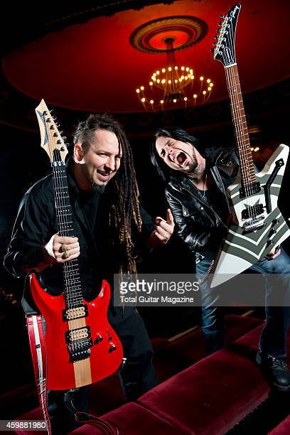 Portrait of musicians Zoltan Bathory and Jason Hook guitarists with American heavy metal group Five Finger Death Punch photographed before a live...