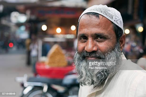 Portrait of Muslim fruit vendor in the bazaar, Jodhpur, Rajasthan, India