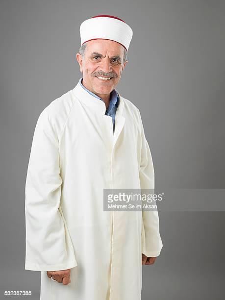 Portrait of muslim imam in religious costume