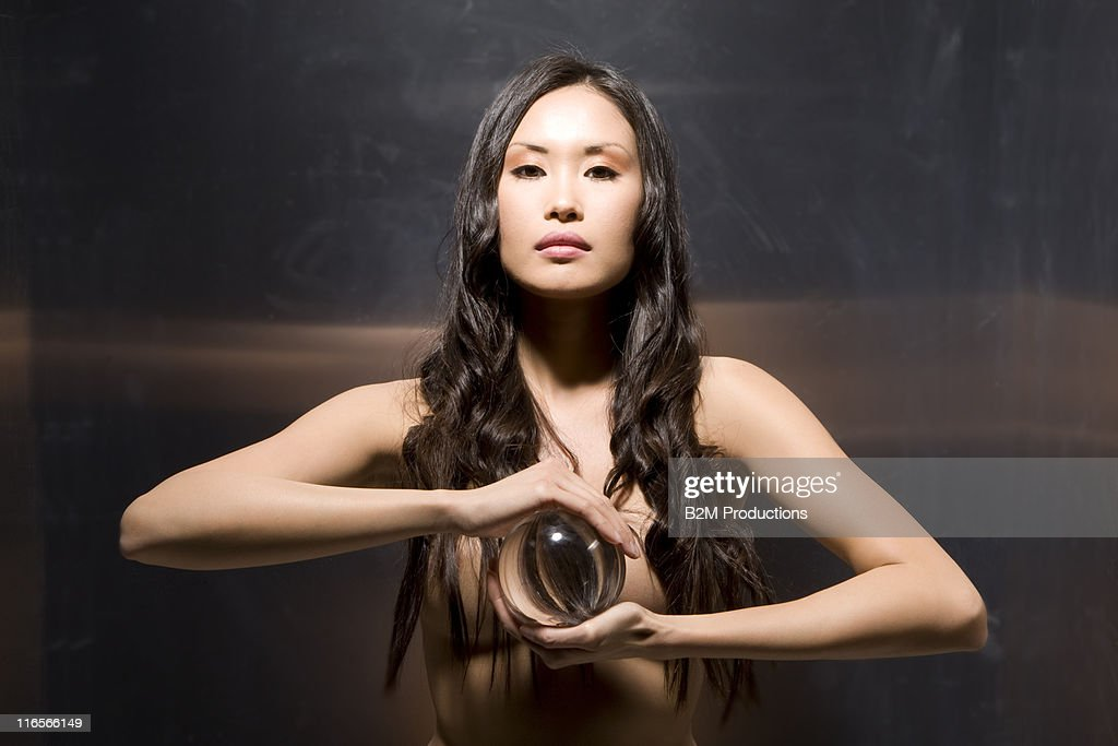 Attractive Naked Woman Holding A Ball. Stock Photo - Image