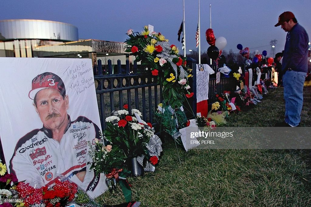 A portrait of NASCAR driver Dale Earnhardt, Sr., adorns a memorial outside Earnhardt's corporate headquarters 19 February 2001 in Moorseville, NC. The memorial was started by fans paying tribute to the NASCAR legend, who was killed 18 February 2001 during a final lap crash of the Daytona 500 NASCAR race.